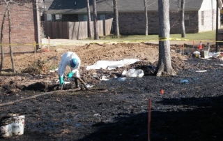 Vacuum removal of oil from affected Mayflower neighborhood